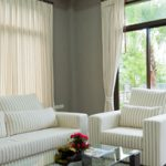 What is the difference between drapery panels and curtains?
